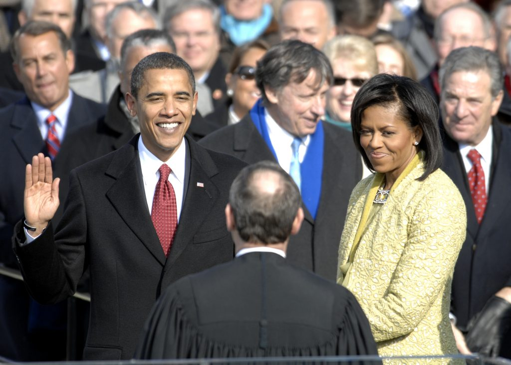 With his family by his side, Barack Obama is sworn in as the 44th president of the United States by Chief Justice of the United States John G. Roberts Jr. in Washington, D.C., Jan. 20, 2009. More than 5,000 men and women in uniform are providing military ceremonial support to the presidential inauguration, a tradition dating back to George Washington's 1789 inauguration. (DoD photo by Master Sgt. Cecilio Ricardo, U.S. Air Force/Released)