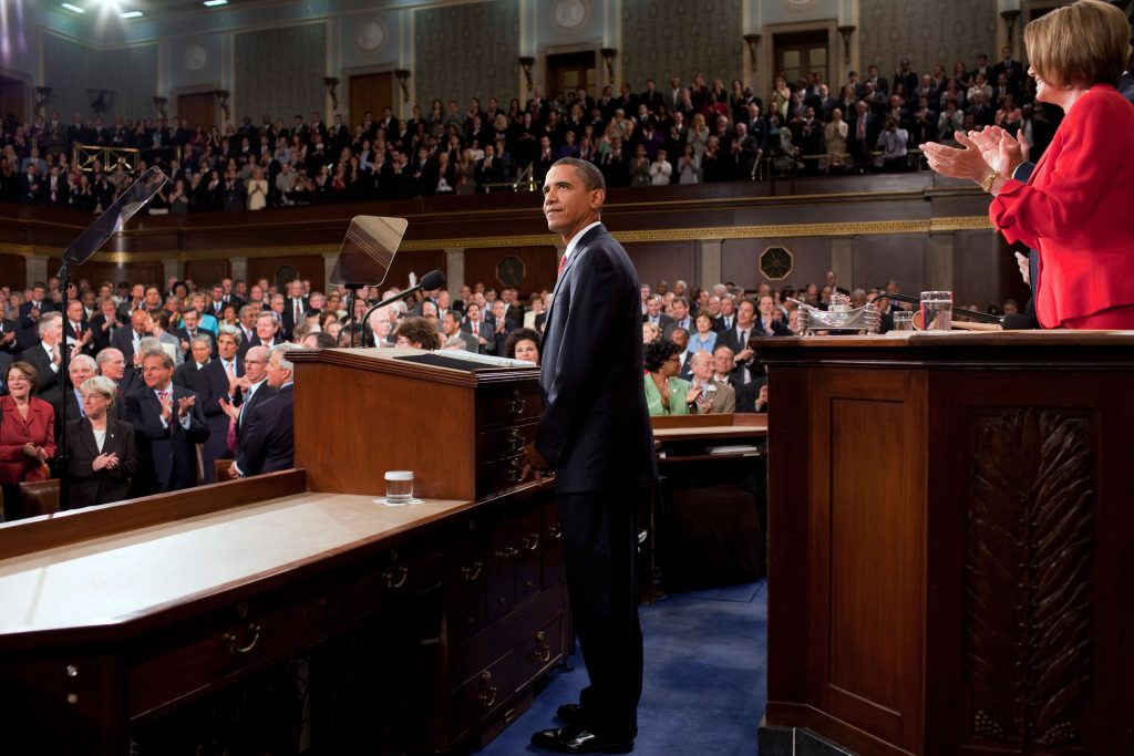 President Barack Obama looks towards the First Lady and guests seated in the gallery of the House Chamber at the U.S. Capitol in Washington, D.C., Sept. 9, 2009. (Official White House Photo by Pete Souza)<br />