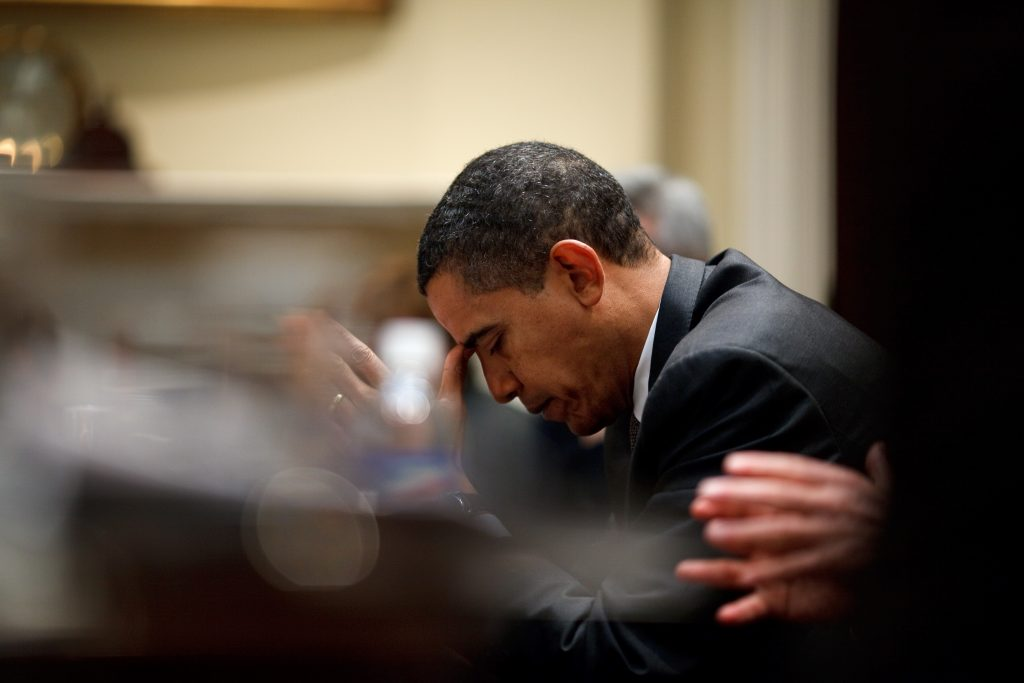 President Barack Obama reflects during a budget meeting in the Roosevelt Room 1/29/09.<br /> Official White House Photo by Pete Souza